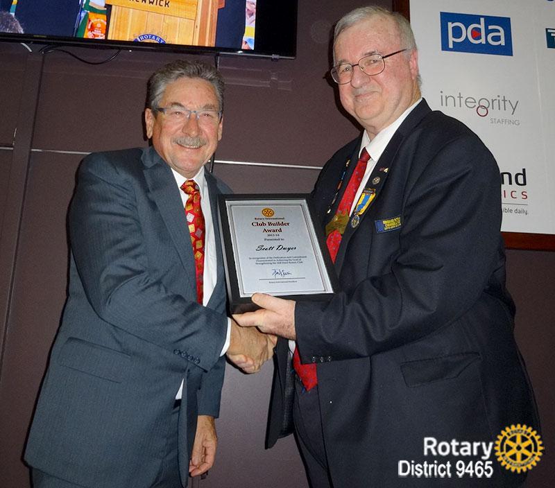 Past President Scott Dwyer receives the Club Builder Award from DG Erwin Biemel