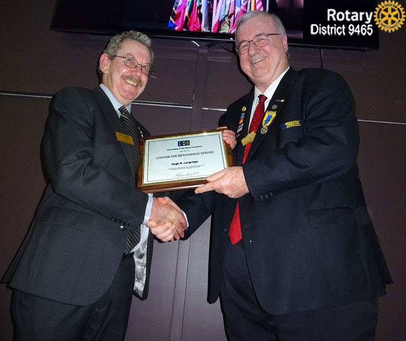 PDG Hugh Langridge receives the Rotary Foundation Citation for Meritorious Service  from DG Erwin Biemel