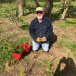 David kneeling with seedlings