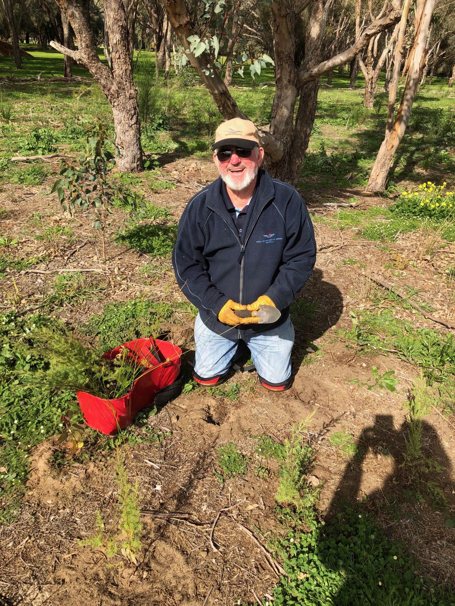 David kneeling with seedlings