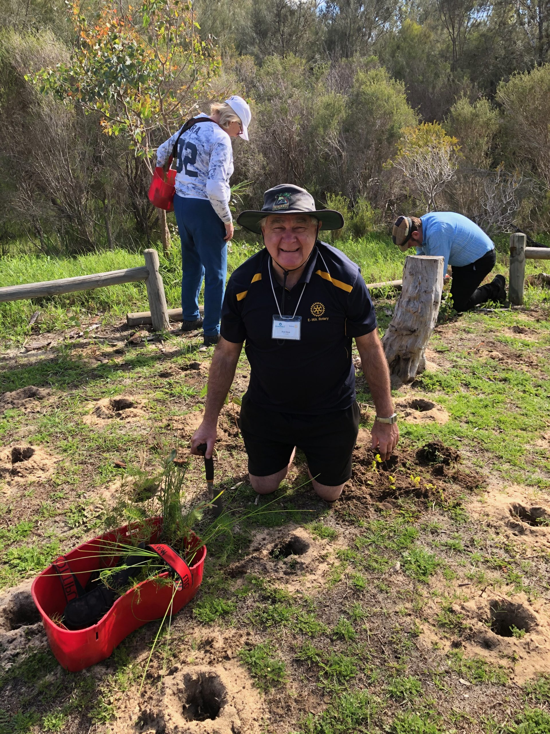 Rod is planting with a digging tool