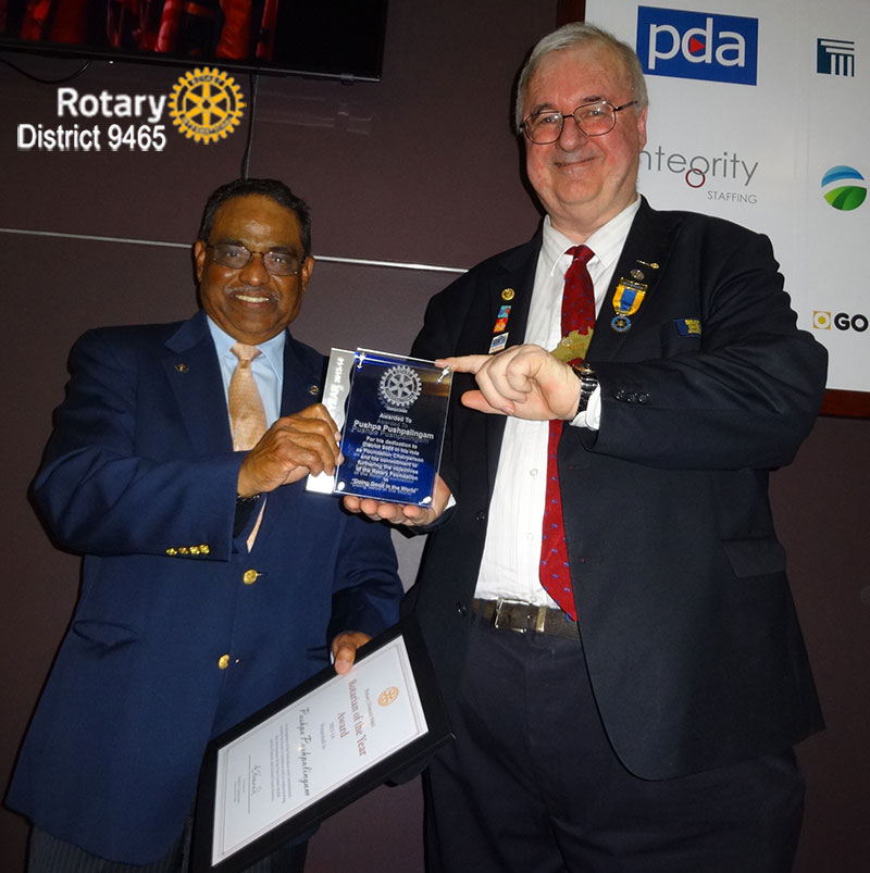 Pushpa Pushpalingam receives the D9465 Rotarian of the Year Award from DG Erwin Biemel