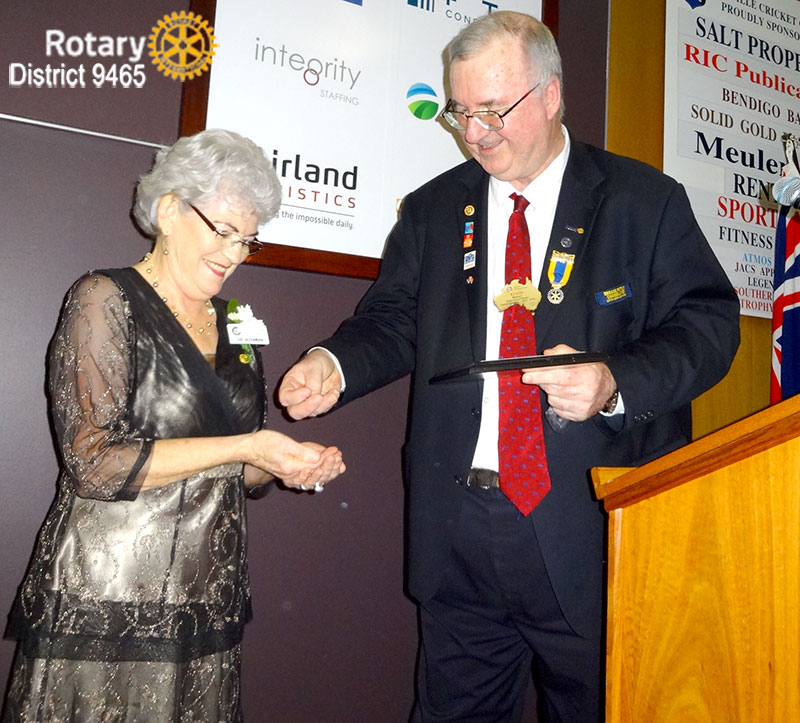 Sue Alexander receiving her RI Rotarian Spouse/Partner Service Award from District Governor Erwin Biemel