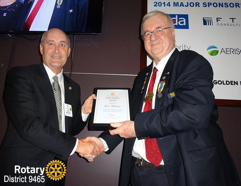 DG Erwin Biemel present the Club Builder Award to Past President Robert Webster of Willetton Rotary